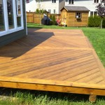 Ground level deck built & stained by Arbor Renovations