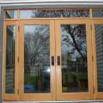 Glass paneled exterior door installation.