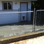 Picture of a chain link fence and patio