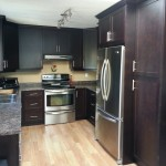 Kitchen cabinets and laminate flooring.