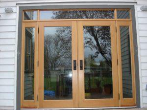Exterior glass double door installation.