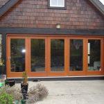 Exterior folding glass doors.
