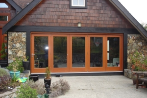Exterior folding glass doors.