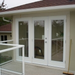 Triple glass french doors off deck..