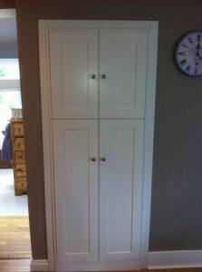 Kitchen pantry white paneled doors.
