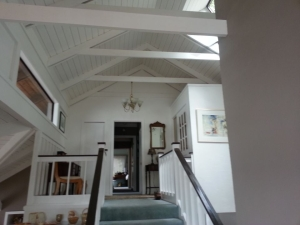 Interior vaulted ceiling and trim painting.