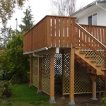 Deck and stairs with lattice privacy screen.