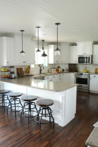 Kitchen renovation with island, marble counter top and white cabinets