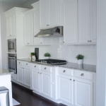 White cabinets and new countertop installation.