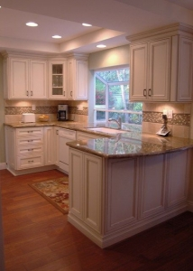 Kitchen renovation showing White Cabinets with Marble Counter-tops