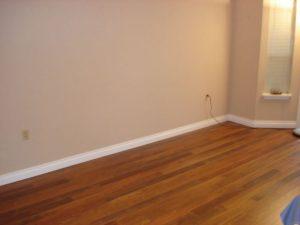 Hardwood flooring and baseboard installation.