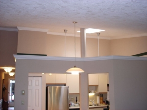 Interior painting and crown molding installation.