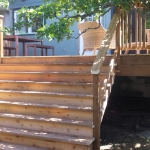 Outdoor Cedar Deck with wide stairs.