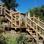 Tiered Deck and Stairs installed on high embankment.